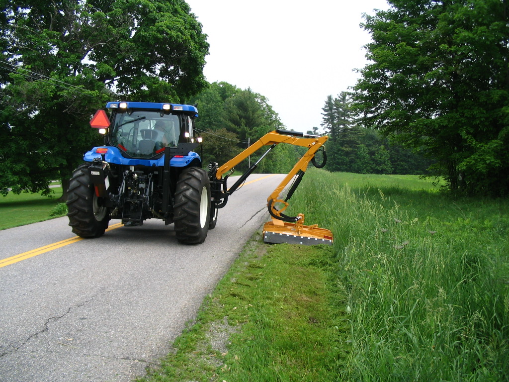 Back of tractor as it mows the roadside