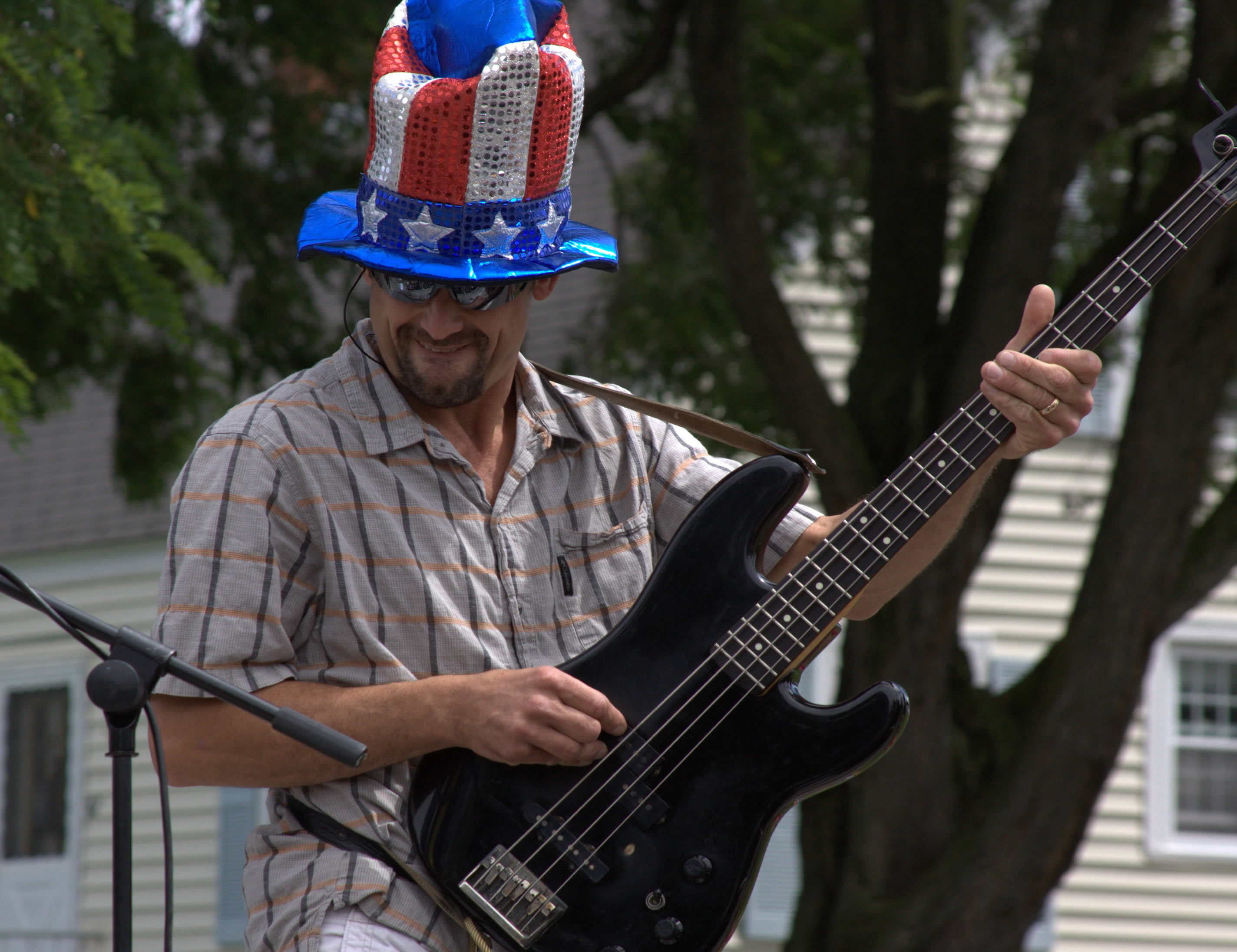 Dude shreds the guitar while wear Uncle Sam hat