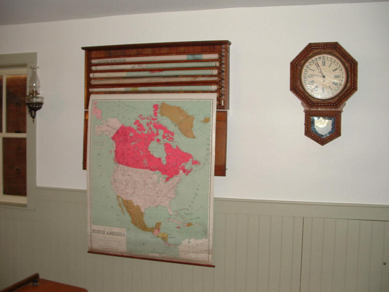 Map and clock hanging on the wall