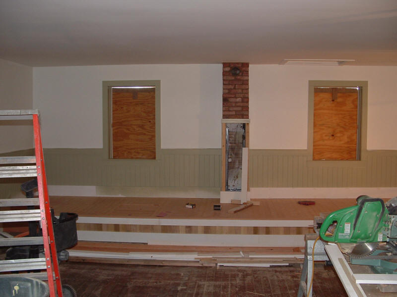 Facade is wainscoted to match rest of the room