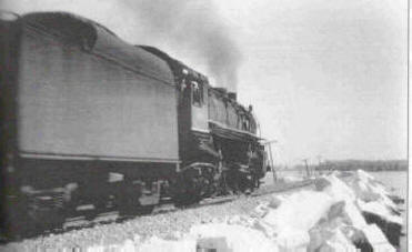 Train pushing through snow
